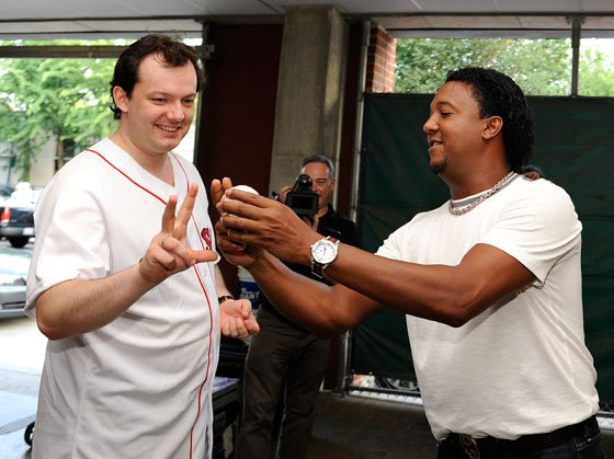 Later in the day Nelsons showed collegiality with other players as Pedro Martinez offer pointers. (Stu Rosner photo)