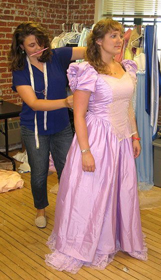 Laura DellaFera being fitted by Caitlin Cisek for her ball gown (Kelsey Ross photo)