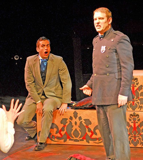 Eduardo Ramos as Jonathan Parker, Justin Hicks as Sheriff Swann (Opera Hub photo)