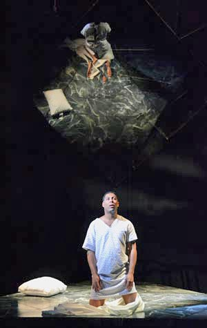 Benjamin Taylor (CFA'16) portrays a man dying of AIDS in the CFA opera Angels in America. (Oshin Gregorian photo)