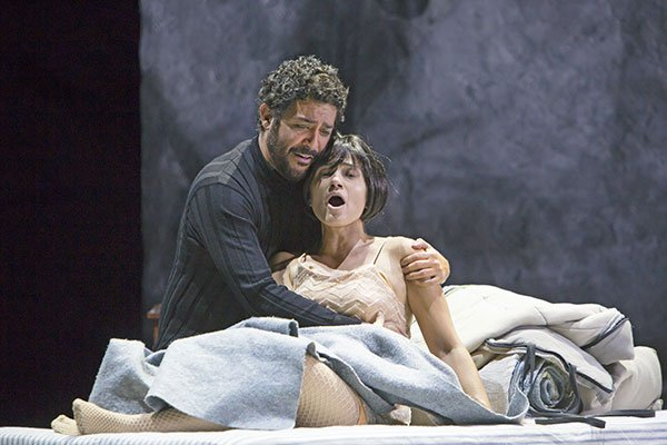 Rodolfo (Jesus Garcia) and Mimi (Kelly Kaduce) embrace in her final moments. (T. Charles Erikson photo)