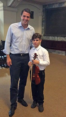 Matthias Schulz, Director of the Mozarteum, Salzburg With thirteen yr old violin soloist Luis Maceiro (Laura Stanfiel Prichard photo)