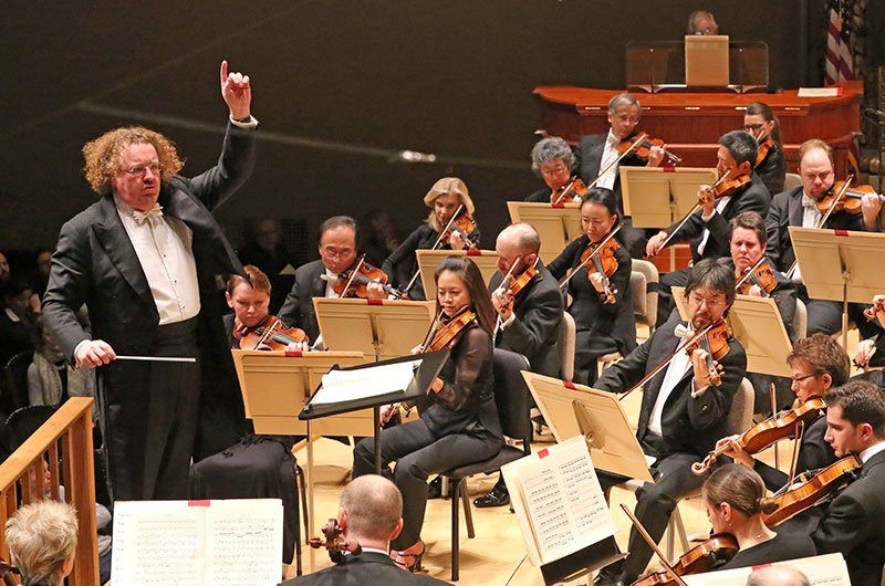 Stéphane Denève conducts; James David Christie in background. (Hillary Scott photo)