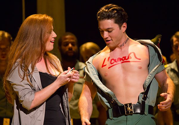 Jennifer Johnson Cano scrawls on the chest of solider Joseph Yonaitis. (T. Charles Erickson photo)